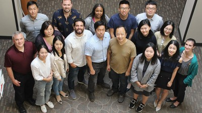 photo of Ph.D. program students and program director
