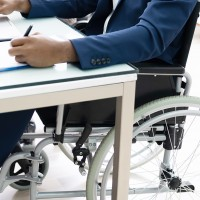 photo of person in a wheelchair at work