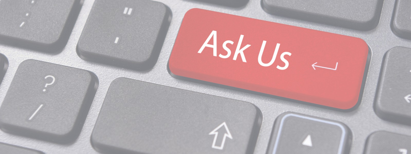 """image of keyboard that says """"ask us"""""""