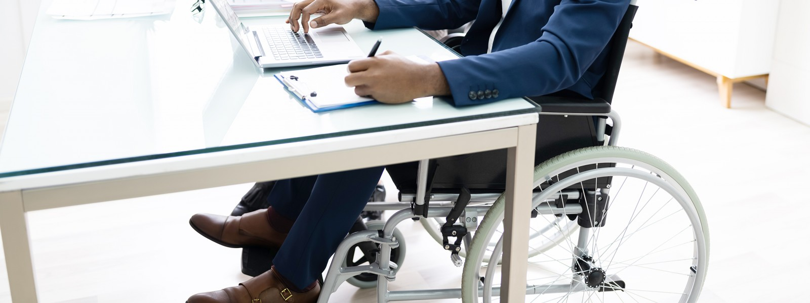 photo of person in a wheelchair in an office